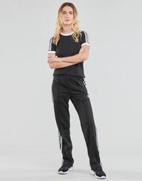 Odjeća Žene  Donji dio trenirke adidas Originals FIREBIRD TP PB Crna